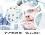 focused senior life science... | Shutterstock . vector #701123584