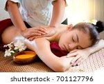 beautiful asian woman receiving ... | Shutterstock . vector #701127796