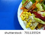 salad with mixed fresh... | Shutterstock . vector #701135524