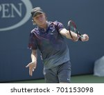 Small photo of New York, NY USA - August 22, 2017: Denis Shapovalov of Canada returns ball during qualifying game against Denis Kudla os USA at US Open 2017