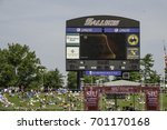 Small photo of CARBONDALE, IL/USA - AUGUST 21, 2017: A realtime video board for spectators in Saluki Stadium at Southern Illinois University shows the Moon hiding part of the Sun during the Great American Eclipse.