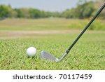 Playing golf. Golf club and ball. Preparing to shot - stock photo