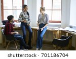 multicultural group of cheerful ... | Shutterstock . vector #701186704