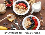 oat flakes in plate with... | Shutterstock . vector #701197066