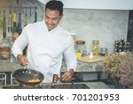 asian chefs  cooking with a... | Shutterstock . vector #701201953