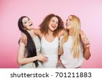 three young women laughing and... | Shutterstock . vector #701211883