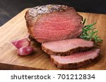 baked meat  garlic and rosemary ... | Shutterstock . vector #701212834