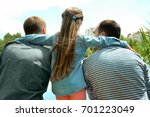 gay couple with daughter on a... | Shutterstock . vector #701223049