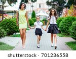 mother with two daughters is... | Shutterstock . vector #701236558