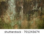 old wall with green moss and...   Shutterstock . vector #701243674