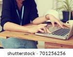 engineer woman safety helmet on ... | Shutterstock . vector #701256256