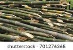 pile of bamboo stalks. | Shutterstock . vector #701276368