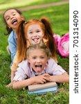 cheerful multiethnic girls... | Shutterstock . vector #701314090