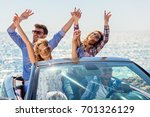 group of happy young friends in ... | Shutterstock . vector #701326129