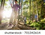confident mature woman crossing ... | Shutterstock . vector #701342614