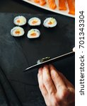 sushi being cut on a board   Shutterstock . vector #701343304