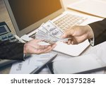 person hand giving money to... | Shutterstock . vector #701375284