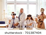 senior teacher teaching biology ... | Shutterstock . vector #701387404