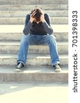 man sitting on the stairs are... | Shutterstock . vector #701398333
