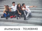group of friends sitting... | Shutterstock . vector #701408440