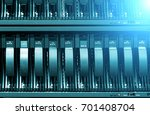 row of hard disks close up with ... | Shutterstock . vector #701408704