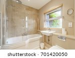 bathroom in a modern family... | Shutterstock . vector #701420050