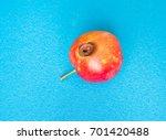 A Rotten Apple On A Light Blue...