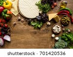 top view of raw pizza dough and ... | Shutterstock . vector #701420536