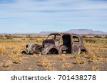 a rusty old abandoned car in... | Shutterstock . vector #701438278