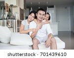 young happy asian family at... | Shutterstock . vector #701439610