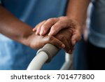 cropped hands of nurse and... | Shutterstock . vector #701477800