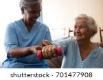 nurse helping senior woman in... | Shutterstock . vector #701477908