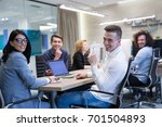 group of a young business... | Shutterstock . vector #701504893
