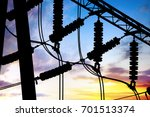 Small photo of Substation lines and equipment, silhouette at dusk.