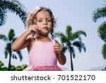 Little Girl Making Soap Bubble...
