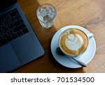 coffee cup hot on wooden table | Shutterstock . vector #701534500