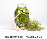 Small photo of Brined pickles in a jar, with all the ingredients for making them (garlic, dill and horseradish)
