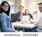 group of a young business... | Shutterstock . vector #701565283