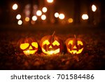 three halloween pumpkins in the ... | Shutterstock . vector #701584486