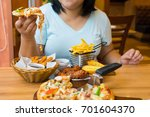 asian woman is holding pizza in ... | Shutterstock . vector #701604370