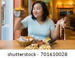 fat asian woman is making... | Shutterstock . vector #701610028