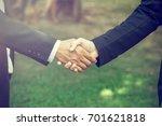 handshake. it is a collective... | Shutterstock . vector #701621818