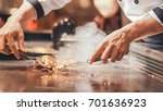hand of man take cooking of... | Shutterstock . vector #701636923
