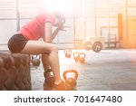 exhausted woman sitting on tire ... | Shutterstock . vector #701647480