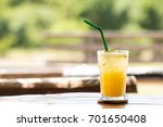 passion fruit juice with ice in ... | Shutterstock . vector #701650408