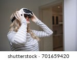 woman wearing virtual reality...   Shutterstock . vector #701659420