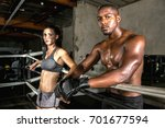 Small photo of Coed gym trainers standing confidently during intense fitness self defense cardio aerobic exercise