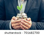 businessman cover growing plant ... | Shutterstock . vector #701682700