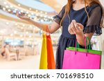 woman holding shopping bags in