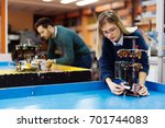 young students of robotics... | Shutterstock . vector #701744083